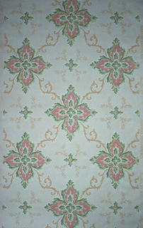 On light blue ground, floral motifs composed of four pink and green flowers with light orange scrolls.