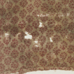 Natural coarse plain cloth ground with all-over print of small rosettes in red.