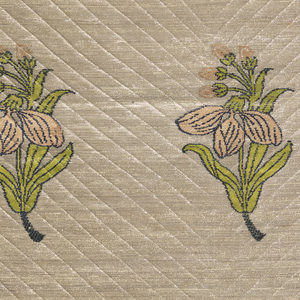 Rows of isolated flowering plant motifs in light pink, yellow-green and light blue with stems curving left or right in alternate rows on a silver background. The textile was stamped or incised in a fine, large-scale, chevron pattern.