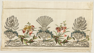 Border fragment of white silk twill embroidered in silk with silver metallic threads, chenille yarns, metal coils and spangles. Symmetrical pattern of fan-shaped sprays and tree forms in silver, flanked by flowers in brilliant polychrome silks.