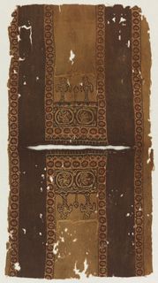 Section of a tunic, probably for a child, with the neck opening in the center; the front and back are identical panels. Below the neck are two roundels each with a figure wearing a mantle and carrying a shield. Below the band hang two figures on chains. The panel is bordered by a series of small roundels containing rosettes or birds.
