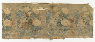Fragment of woven silk with a repeating pattern of a bird perched on a branch of roses arising from a mound. In pale blue, green, and pink silks on a silver metallic ground.