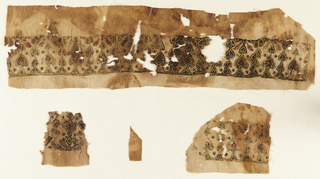 Tiraz, embroidered horizontal band of palmette motifs in polychrome.
