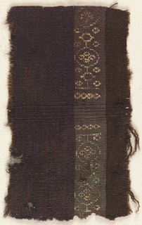 Fragment of dark brown wool tapestry with a pattern band incorporating circular patterns in tan.