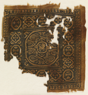 Fragment of a square tapestry woven panel of purple wool and undyed linen. Some slit-tapestry. Design showing large roundel with scrolls, and an animal form at center. Geometric shapes at border.