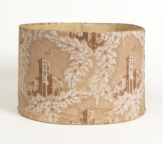 Cardboard bandbox covered with machine printed wallpaper. On light brown background, white and darker brown leaf design, edged with pin work, enframing castellated buildings. Bottom covered with newspaper reporting events in Michigan of 1844-45 and mentioning the Mexican War (1846-48).