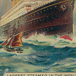 """Rectangular, curved corners, snuff box style container, cover features polychrome, printed decoration of large cruise ship on the water with mast and American flag at top, smaller sailboat in front and in background, inscribed at top """"White Star Line,"""" small red banner with star to left, """"R.M.S. Olympic, 45.324 Tons"""" inscribed at right, """"Largest Steamer In The World"""" inscribed below. On underside """"Cadbury, Bourneville"""" impressed in metal. Striker on underside."""