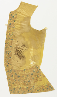 Pair of waistcoat fronts with curved hems and flap pockets. Yellow silk satin, embroidered in satin stitch on front, lower and pocket edges with a dense, small-scale floral design in pale green, yellow and pinks. Badly damaged.