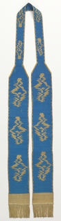 Blue silk with abstract ornaments in gold; the edges are gold and each end has bands of gold and gold fringe.