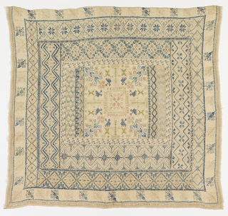 Large square sampler by Maria Brigida Sanchez Mansilla is embroidered with a central square containing floral and bird motifs. Center is surrounded by a series of borders containing a variety of geometric and floral patterning.