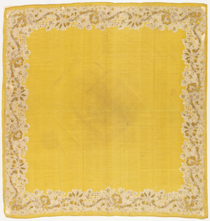 Yellow silk handkerchief with printed border in brown and yellow on cream showing a flowering vine on a stippled ground. Hemmed on the two ends.