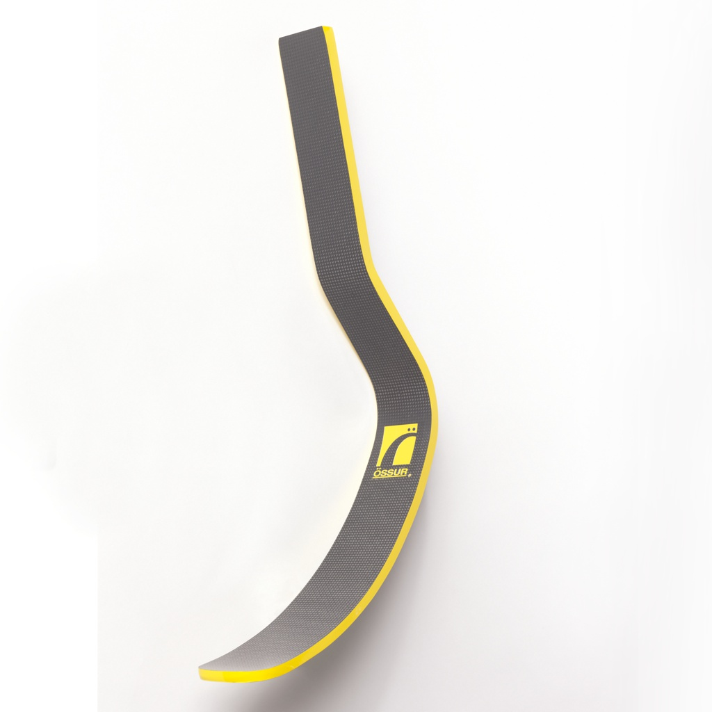 Stiff, contoured J-form band of black carbon-fiber epoxy resin;  yellow Össur logo in center; yellow at edges.