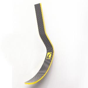 Stiff, contoured J-form band of black carbon-fiber epoxy resin;  yellow Össur logo in center; yellow at edges.