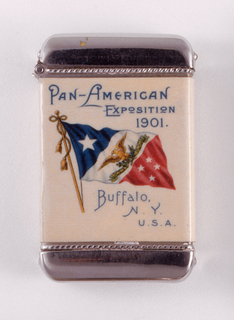 "Rectangular, featuring printed decoration of a red, white and blue banner, one large star in upper left, blue corner; golden eagle set against white ground on diagonal central band, eagle situated above green banner that is inscribed ""Pan 1901""; 4 small stars on lower right, red corner. ""Pan-American Exposition 1901"" inscribed in blue above flag; ""Buffalo, N.Y., U.S.A."" inscribed in blue below. Reverse features representations of North and South America in the forms of fin-de siecle style women draped in flowing scarfs, their hands clasped at the isthumus, where the 2 continents meet. Inscribed in black on box side is ""Made by the Whitehead & Hoag Co., Newark, , N.J.""; inscribed on opposite side: ""Designs Copyrighted by Pan-American Exposition Co."" Lid hinged on side. Striker on bottom."