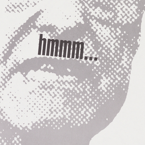 "Description: Image of George Bush with ""hmmm..."" across face"