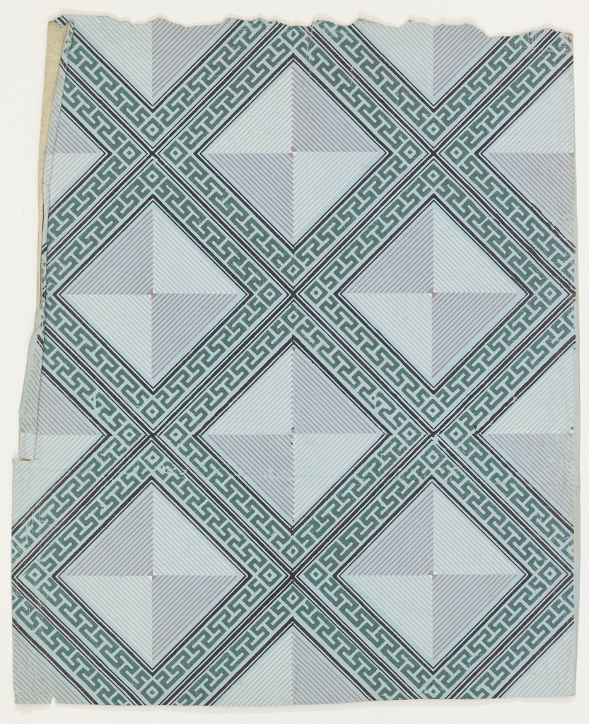 On light blue ground, Greek key frame printed in green with geometric pyramid design in center, printed in white and gray.