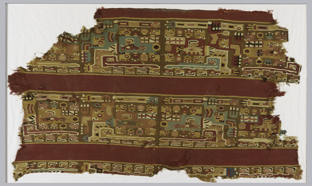 Fragment of a mantle with two wide bands of multi-color desigh of winged spear-bearer figure, set off by narrower bands of dark red. Design in shades of red, brown, green, blue and light yellow.