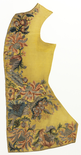 Two waistcoat fronts with a dense, large-scale floral border ornamenting the center front and lower edges and waistline. Embroidered in 13 colors of silk chenille, 4 metallic yarns, 2 silk yarns plied with  metal, strips of flat metal and coils of wire couched on a brilliant yellow silk foundation.