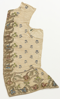 Waistcoat without collar embroidered with silk and metallic yarns. Cream brocade foundation with trailing florals, embroidered with scattered blue flowers throughout and polychrome flowers along center, bottom and curving pocket flaps.