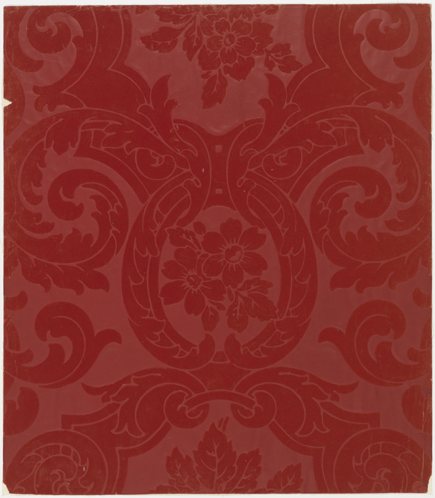 Simulates a damask design drawn in a large scale. Rococo and acanthus leaf scrolls forming medallions which contain clusters of single roses of five or six petals. Wool flock design is on a field of fine embossed horizontal lines; red two-toned wool flock on glazed embossed field.