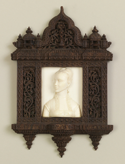 carved scroll teakwood niche surrounding a high relief portrait bust in ivory