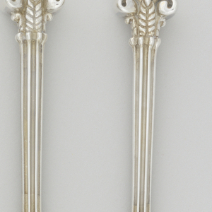 Chopsticks with Corinthian column-like handles, fluted with scrolls.