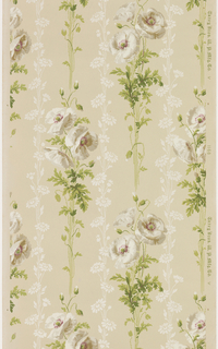 Floral stripe design, with columns of white poppy flower bouquets on stems separated by narrower bands of daisy-like flowers on stems. Printed in white, lavendar, and green on a taupe ground.