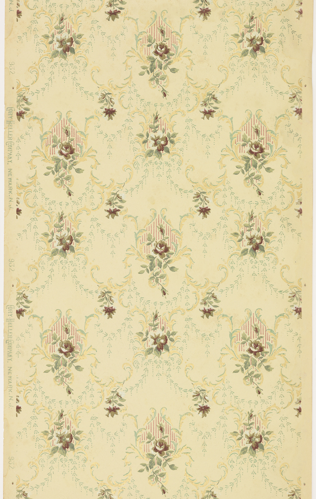 Striped floral medallions connected by swags and scrolls. Printed in red, green, brown, and metallic gold on light yellow ground.