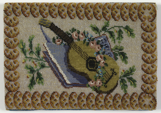 Beaded fabric used to cover paper notebook. Image of a guitar, book, bowl and flowers on a white ground with a border on one side and a leaf pattern in repeat on a blue background on the other side. Loops at edge to hold pencil; a pouch inside each cover. German script on papers inside, with date 1831.