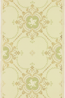 Trellis or grid pattern composed of quatrefoils and chains of bell flowers. The interior of each grid conatins a quatrefoil formed of foliate scrolls, with a florish in the center. Printed in green, tan, metallic gold and white mica on a pale green ground.