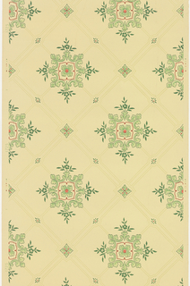 Trellis or grid pattern with large quatrefoil in center of each grid, smaller quatrefoil at intersection of lines. Printed in green and red on light yellow ground.