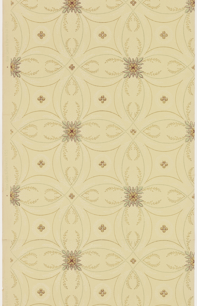 Square floral boss in the center of quatrefoil motif. Printed in green, brown, tan, and white mica on light tan ground.