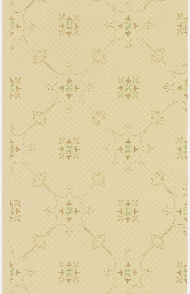Treelis or grid pattern with a quatrefoil motif filling the center of each grid, as well as the intersection where the four corners meet. Printed in green and brown on spotted tan ground.