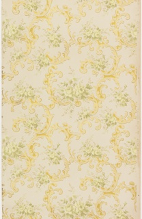 Rococo inspired ceiling paper with bold pattern of bold, asymmetrical foliate c and s-scrolls and floral sprays. Scrollwork is printed in tones of yellow and gold, floral sprays in muted greens. Khaki ground.