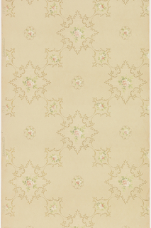 Rococo inspired ceiling paper with alternating pattern of large quatrefoils and smaller concave diamond shapes. Cells are outlined in c and s-scrolls, and contain pink rose blossoms. Pattern of horizontal, white lines is present in concave-diamond cells. Pattern is printed in pinks, white, greens and gold on khaki ground.