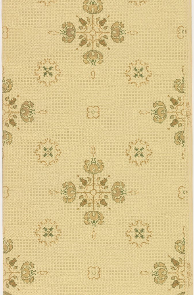 Large medallions feature line-work crosses with stylized blossoms at finials and intersections. These larger medallions alternate with quatrefoil blossoms as well as smaller, octagonal medallions outlined by c-scrolls. Medallions and blossoms are printed on top of an allover diaper pattern. The simple outlines of the medallions and textured look of the diapered background make the pattern resemble an embroidered sampler. Pattern is printed in gold, green and tan on a khaki ground.