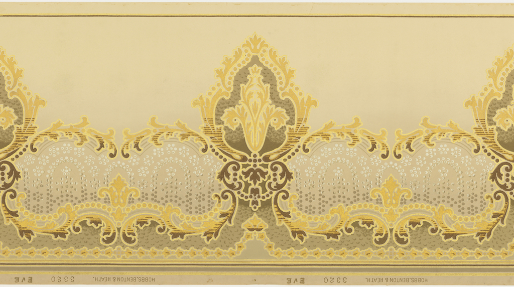 A repetitive design of urn-shaped medallions interconnected by scrolling acanthus leaves upon a beige ground to lower half of which is filled with gray and white pearls. Below, a scrolling acanthus vine in a wave-like pattern. Printed in beige, olive green, bronze, copper and gold.