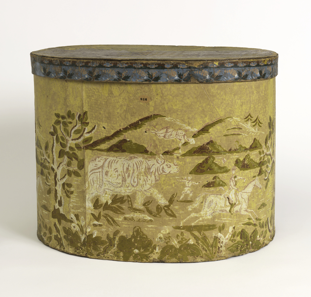 "Box bottom has fanciful scene of rhinoceros with hunters on foot and on horseback, with background of mountains. Lid has view of large building on manicured grounds, with legend of the ""Deaf and Dumb Asylum""."