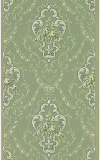 Acanthus scroll medallion containing a floral bouquet, surrounded by more scrolls and floral swags. Printed in green and white on green ground.
