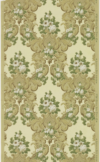 Open medallion framework composed of acanthus scrolls, each containing a floral bouquet. Printed in green, white, light yellow, brown, and metallic gold on tan ground.