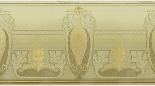 "A repeating design of art nouveau vase-shaped cartouches interspersed by similar, but smaller gold fleur-de-lis cartouches centering abstracted ""stone walls"" upon a beige grid-filled background within borders of olive green and gold. Printed in beige, tan, olive green, gray, white, gold and cream."