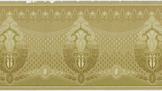 A repeating design of lozenge cartouches, connected by a repetitive pattern of dark and light dots resembling mest, below a border consisting of a geometric design hung with tiny pearls. Printed in beige, tan, cream, olive green and brown.