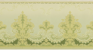 Frieze featuring large and small fleur-de-lis made of acanthus leaves and connected by a lace-like, scalloped border. The fleur-de-lis repeat horizontally, and rise up from the bottom of the panel. The top is bordered by a thin line of repeating curvilinear shapes, below which is a faint, horizontal pattern of vegetal c scrolls. Design is printed in gold, tan and olive green on a beige ground.