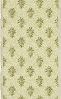 Foliate motifs resembling fleur de lis forming diagonal rows, printed over secondary pattern of interlocked C scrolls or tracery. Printed in shades of green and metallic gold on pale green ground.