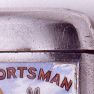 """Rectangular, rounded corners and sides, featuring polychrome enamel decoration of kangaroo holding cricket bat with seated lion in background, inscribed above animals """"The Sportsman"""" and below """"for Cricket News"""". Reverse features very worn inscription """"SEP 1899"""". Lid hinged on upper left. Striker on bottom."""
