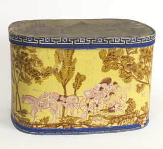 Box shows figures mounting into a carriage. Cover shows buildings in a wreath of flowers. Inside of box decorated with spatter of blue and white on pale blue field. Printed in pink, olive and brown on yellow ground.