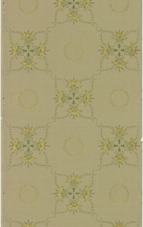 Quatrefoil motifs composed of foliate scrolls and floral bouquets. A wreath is centered in the void between quatrefoils. Printed in green and metallic gold on tan ground containing weave pattern.
