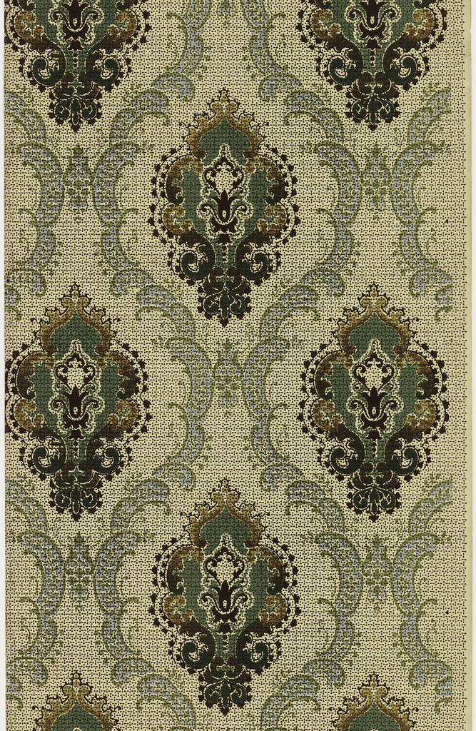 Large stylized floral medallion. Each medallion is enclosed within a scrolling ogival framework. Printed in green, blue, and tan on patterned ground.