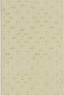Circle motif alternating with a motif of four crossed arrows. Printed in green and ocher on tan ground containing a rows of dashes.