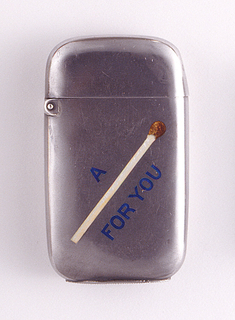 """Rectangular, rounded sides and corners, featuring word/picture rebus, inscribed in blue enamel """"A [Match] For You"""", a matchstick with red tip substituted for the word """"Match"""". Reverse inscribed """"Addie to James"""". Lid hinged on upper left. Striker on bottom"""